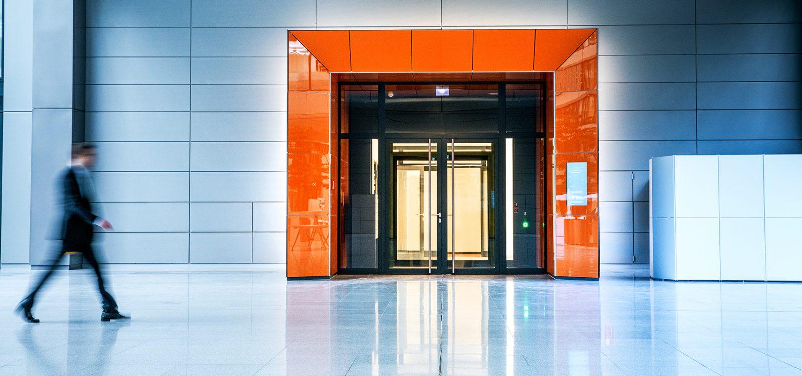 Blurred businessmen walking inside a modern building
